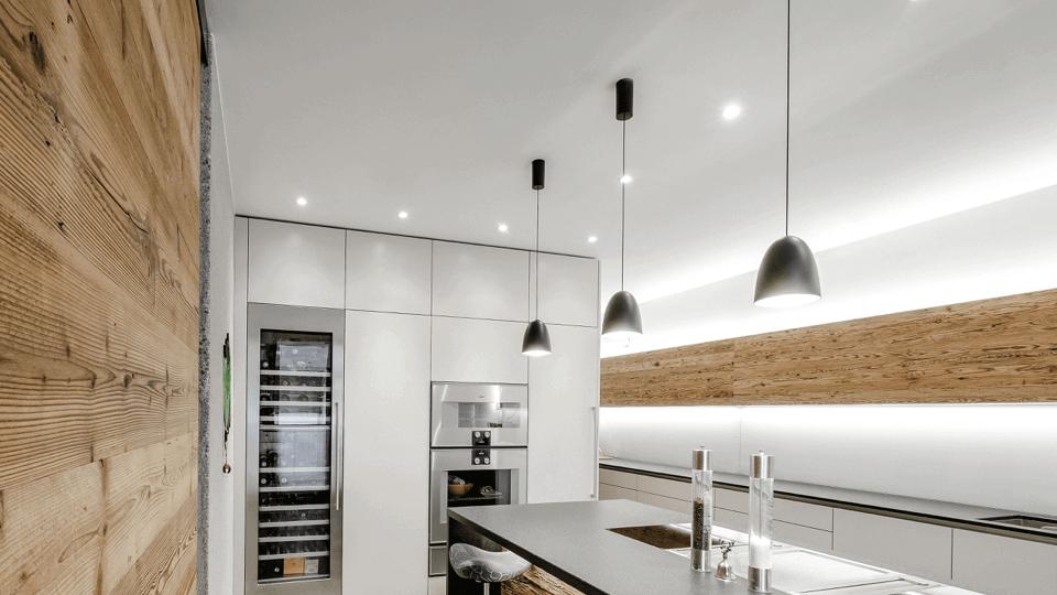 Modern kitchen with smart lighting installed.